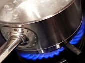 pic of boiling water  - Water boiling in the metal bowl with handle on the gas flame cooker - JPG
