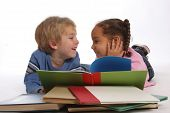 stock photo of girl reading book  - two happy young kids reading books together - JPG