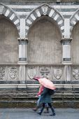 Santa Maria Novella Church; Florence; Italy With Two Women Walking With Umbrellas