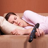 Young Woman Sleeping In Front Of Tv