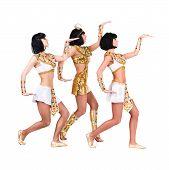 Dancing pharaoh women wearing a egyptian costume.