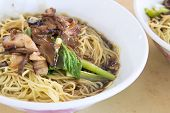 image of wanton  - Penang Malaysia Wanton Mee Barbeque Pork Noodle Bowl Closeup - JPG