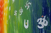 stock photo of swastik  - A holy sign called om is painted on Wall - JPG