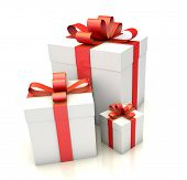 Three White Gift Boxes With Red Ribbon On White Floor