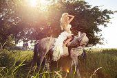 Beautiful Photo Of Blonde Sensual Bride Riding A Horse.