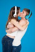 Boy And Girl Kissing, Wearing Headphones In The Studio
