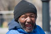 Happy And Laughing Homeless African American Man