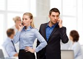 business, technology, communication concept - businesswoman and businessman with cell phones calling