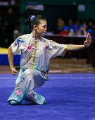 KUALA LUMPUR - NOV 03: Phoon Eyin of Malaysia shows her fighting style in the 'changquan compulsory' event at the 12th World Wushu Championship on November 03, 2013 in Kuala Lumpur, Malaysia.