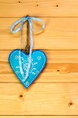 Turquoise Heart On Wooden Wall
