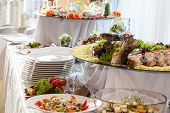 stock photo of buffet lunch  - Catering different colorful snacks at wedding reception - JPG