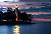 image of shoreline  - Point Aux Barques Lighthouse beacon shines over the waters of Lake Huron - JPG