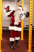 Santa Claus physical condition training before Christmas time in gym