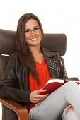 Woman Red Shirt Black Jacket Sit Read Smile