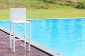 White Chiar Beside The Swimming Pool