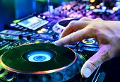 image of disc jockey  - Dj playing the track in the nightclub at party closeup - JPG