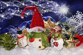 image of figurine  - christmas decoration with three funny snowmen figurines at night background - JPG
