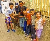 FES, MAROCCO - October 15 2013 : Kids with their sheep on Eid al-Adha. The festival is celebrated by