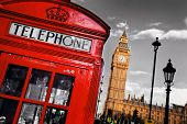 Red telephone booth and Big Ben in London, England, the UK. The symbols of London on black on white