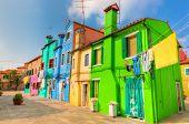 Colorful houses on Burano island, near Venice, Italy. Sunny day.