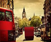 Busy street of London, England, the UK. Red buses, Big Ben in the background.