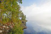 Peninsula On A Foggy Lake