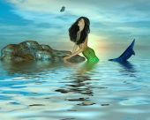 image of nymphet  - One mermaid in the middle of the ocean looking at a butterfly - JPG