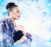 Winter Woman in Luxury Fur Coat. Beauty Fashion Model Girl in Blue Fox Fur Coat. Beautiful Luxury Wi