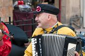 Jerusalem, Israel - 15 March 2006: Purim Carnival Street Musician Plays The Accordion.