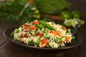 stock photo of sunflower-seed  - Vegetarian quinoa dish with green asparagus and red bell pepper sprinkled with parsley and roasted sunflower seeds (Selective Focus Focus on the asparagus heads on the dish)