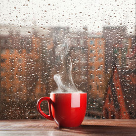 pic of steam  - Steaming coffee cup on a rainy day window background - JPG