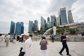 SINGAPORE - NOVEMBER 05, 2012: Tourists on the main promenade in Downtown Core. Quay Marina Bay is a