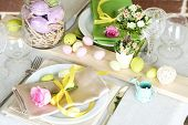 Beautiful holiday Easter table setting, on bright background