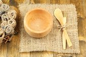 Rustic table setting with plate, fork and spoon, on wooden table