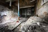 stock photo of locksmith  - an old empty desolate dirty locksmith workshop poor light - JPG