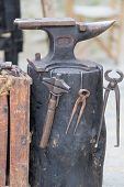 image of anvil  - Antique iron anvil in a medieval exhibition - JPG