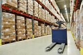 stock photo of forklift  - Manual forklift pallet stacker truck equipment at food warehouse - JPG