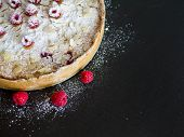 Mascarpone Pie With Fresh Raspberries, Almond And Sugar Powder On A Black Background