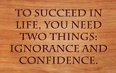 To succeed in life, you need two things, ignorance and confidence - quote by Mark Twain on wooden red oak background