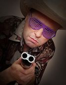 Gangster with shotgun aimed at you. Legal defense and gun control concept.