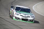 Fort Worth, TX - Apr 04, 2014:  Kyle Busch (18) brings his race car through the turns during a pract