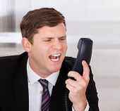 Businessman Shouting On Telephone