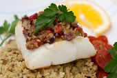 foto of halibut  - Baked halibut with olive tapenade crust garnished with couscous fried cherry tomatoes and fresh parsley - JPG