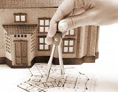 Female architect hand and house model