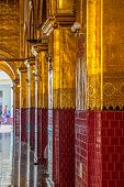 stock photo of muni  - Mahamuni Buddha temple entrance hall beautifully decorated - JPG