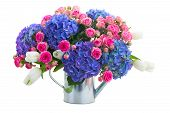 boquet of white tulips, pink roses and blue hortensia flowers