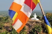 Buddhist flag and Buddha, Mihintale, Sri Lanka