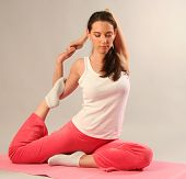 beautiful young woman practicing yoga