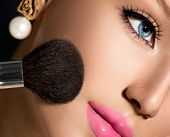 Makeup. Make-up Applying closeup. Cosmetic Powder Brush for Make up. Beauty Girl with Perfect Skin.