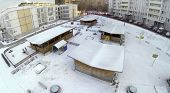 Aerial view to kindergarten with playground at residential district in the winter.